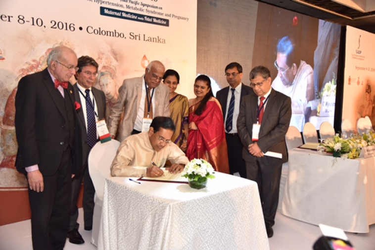 Signing Colombo Dec.jpg