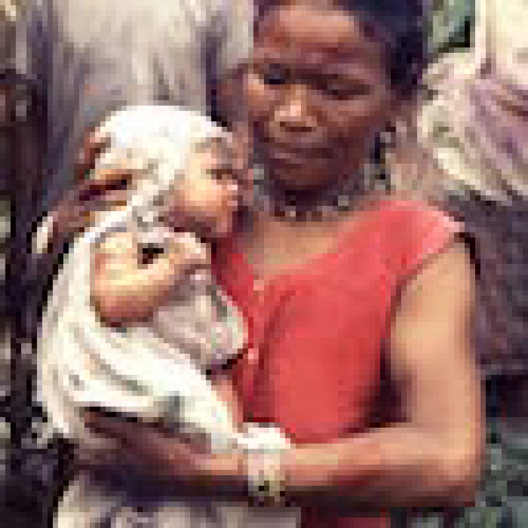 adult-female-holding-a-very-young-infant-whod-recently-received-a-primary-smallpox-vaccination copy.jpg